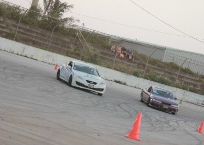 Dan Aclaro in Cars Plus Hyundai Genesis chased by Jaimee Mendiola - photo by Von Burrell